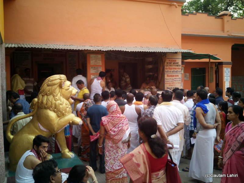 At Gaya, Pilgrims gathered around for getting directions from the BSS officials by Gautam Lahiri