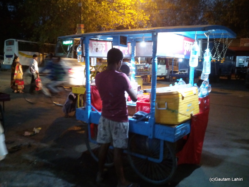 At Gaya, A local vendor with his array of fried food and cold drinking water was a welcome sight for the travel-weary visitors at Gaya by Gautam Lahiri