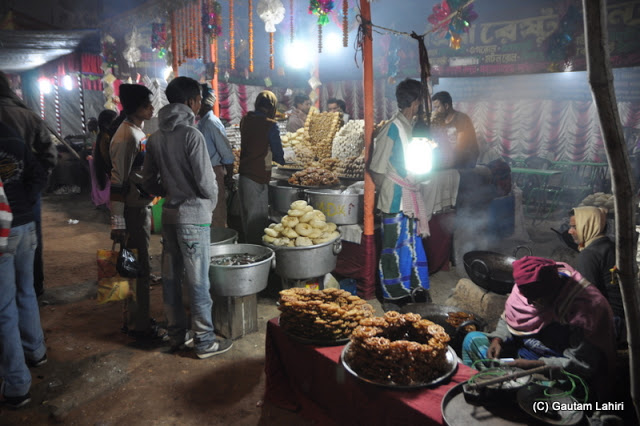 An array of fried food ready to be served at Santiniketan poush mela, West Bengal, India by Gautam Lahiri