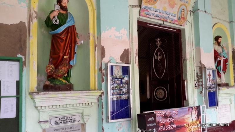 The Church entrance has a very beautifully decorated huge wooden door in Chandannagar by Gautam Lahiri