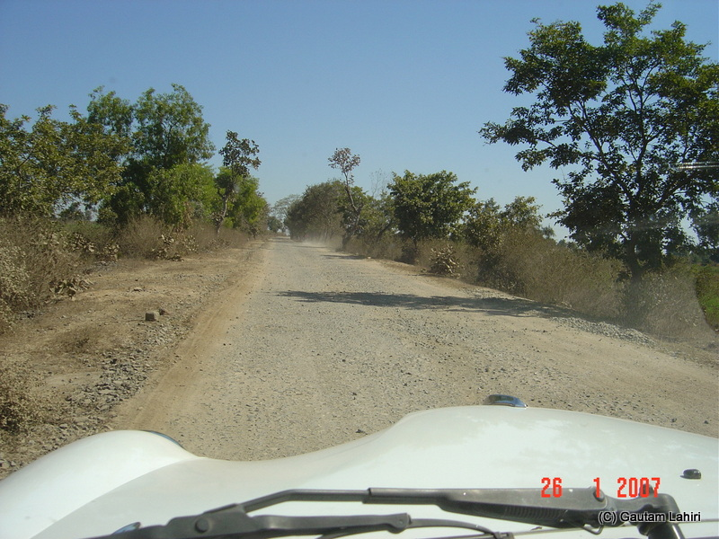 Treacherous road section, bringing down the speed to about 10 kilometre an hour. The driver informed us that during the summer months, the temperature crosses fifty degrees Celsius from Nagpur to Kanha forest reserve by Gautam Lahiri