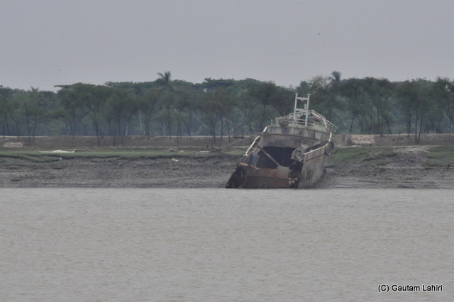 We captured this image of a big trawler, broken off in the middle while she was trying to carry cargo across the river. The wreckage was found moored on the Bangladesh bank of the Ichamati at Taki, West Bengal, India by Gautam Lahiri