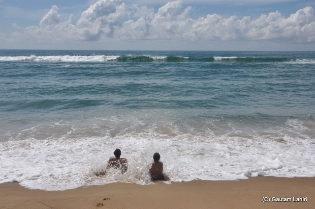White frothy waves laced with sands washed us all over  at Puri, Bhubaneshwar, Odisha, India by Gautam Lahiri