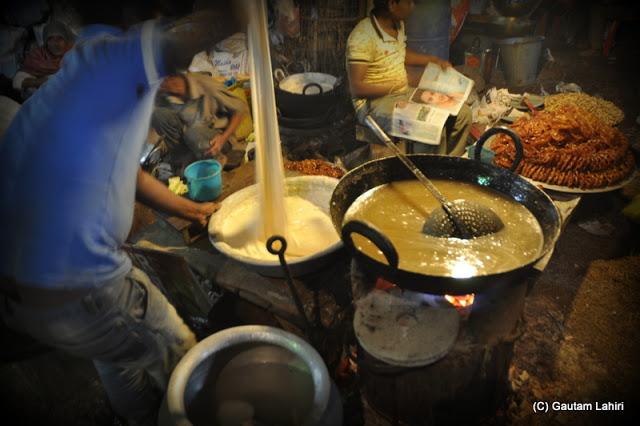 The batter mix for the jalebi at Santiniketan poush mela, West Bengal, India by Gautam Lahiri
