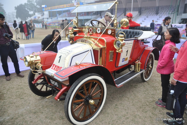 1906 Renault Freres, 8 Horsepower (HP), 2 cylinders flashing red as a youngster waiting to touch her  at Kolkata, West Bengal, India by Gautam Lahiri