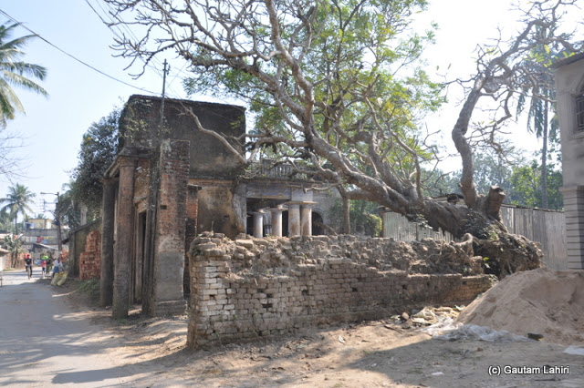 Old houses stared at us as we made our way through the town in Purbasthali by Gautam Lahiri