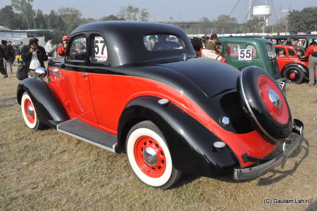 1938 Plymouth coupe, resplendent in red and black makes a bold statement of beauty and design at Kolkata, West Bengal, India by Gautam Lahiri