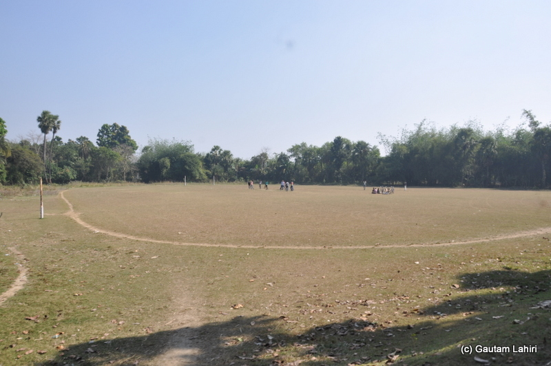 A football or soccer field was preparing itself for a game of soccer as we trundled past it in Purbasthali by Gautam Lahiri