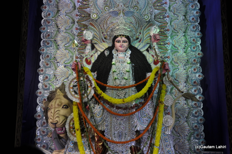 The idol of Jagadhatri, resplendent with all the jewellery, weapons and she sits on a lion in Chandannagar by Gautam Lahiri