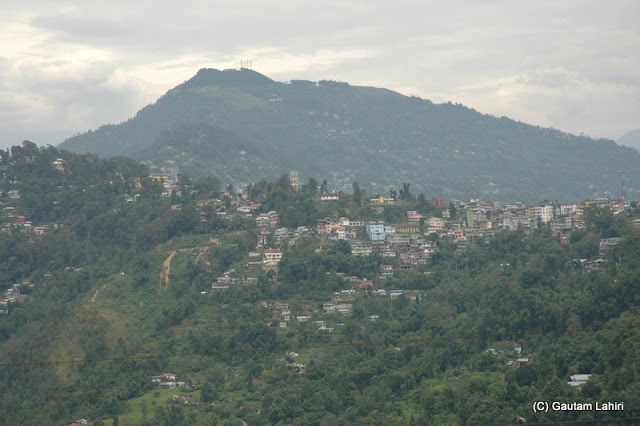 Darjeeling town with its small houses hugged the hillsides and the valley like a necklace  at Darjeeling, West Bengal, India by Gautam Lahiri