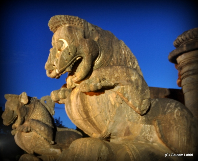 Simha gaja, at the entrance of the temple where the lion is crushing the elephant underneath  at Puri, Odisha, India by Gautam Lahiri