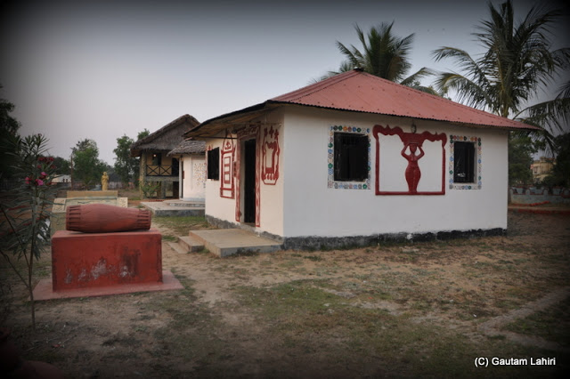 Another tribal cottage styled beautifully that one can seriously believe that a group of villagers with bows and arrows will rush out to greet you  at Santiniketan, West Bengal, India by Gautam Lahiri