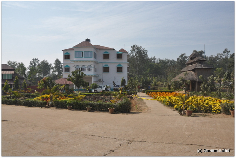 A flower laden walkway led us to a building where refreshments soothed us at Joypur forest, Bankura by Gautam Lahiri