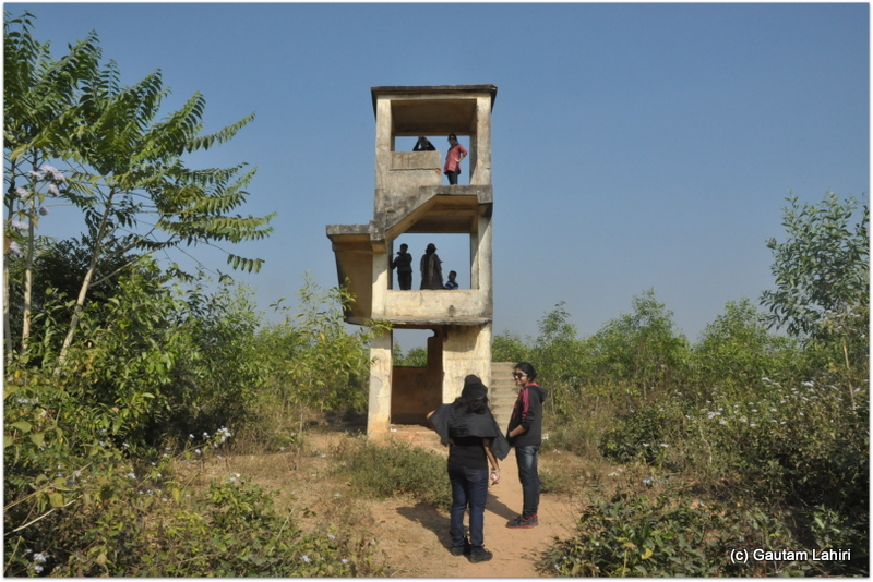 The broken solitary watch tower that in those days had sentries perhaps guarding the British airfield at Joypur jungle, Bankura by Gautam Lahiri