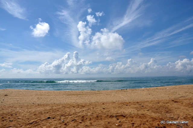 The gurgling Puri's sea green waters met the cloud studded azure sky  at Puri, Bhubaneshwar, Odisha, India by Gautam Lahiri