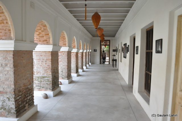 Black and white pictures hung on the walls of this veranda showing how this place looked before the repair was done at Bawali Rajbari, Kolkata, West Bengal, India by Gautam Lahiri