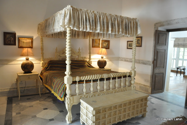 An upmarket room with off-white colored surroundings is sure to give a visitor a night right out of the early 1900s' at Bawali Rajbari, Kolkata, West Bengal, India by Gautam Lahiri