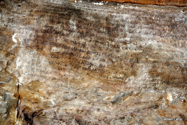 A huge rock outcrop had these 117 line inscriptions from 4th century BC, probably Brahmi script conveying historical facts about the Karavela king  at Bhubaneshwar, Odissa, India by Gautam Lahiri
