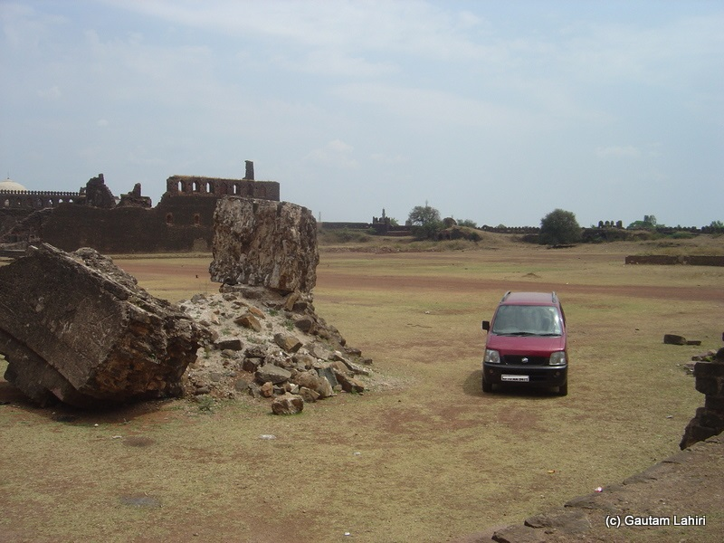Our metal horse parked herself over the fort ground after climbing a gradient. Smashed and destroyed, the long and tall hallways lined up her two sides at Bidar fort by Gautam Lahiri