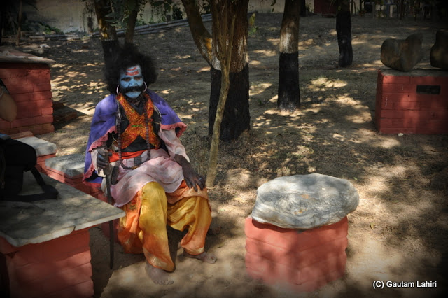 Mahishasura sitting below a tree to start his play  at Santiniketan, West Bengal, India by Gautam Lahiri