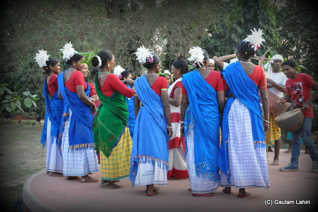 Santal village girls dancing to the tune of the rustic music which stopped us on our track   at Santiniketan, West Bengal, India by Gautam Lahiri