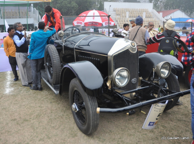 A gleaming, midnight black 1922 Crossley 25 HP, 4 cylinders is being readied for the rally  at Kolkata, West Bengal, India by Gautam Lahiri