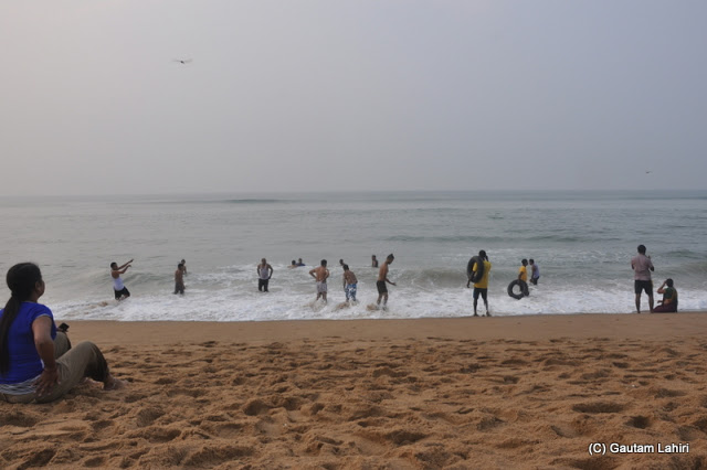 The playful bathers refuse to come out of the sea  at Puri, Bhubaneshwar, Odisha, India by Gautam Lahiri