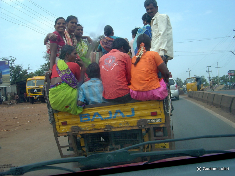 Perched on top of a 2 inches wide metal frame, about twenty people merrily sat and swayed as the notorious three wheelers made valiant attempts to carry on and competed with the cars as we neared the town of Bidar from Hyderabad by Gautam Lahiri