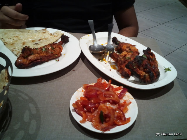 Tandoori chicken, butter nun accompanied with garnished onion rings at Joypur forest, Bankura by Gautam Lahiri