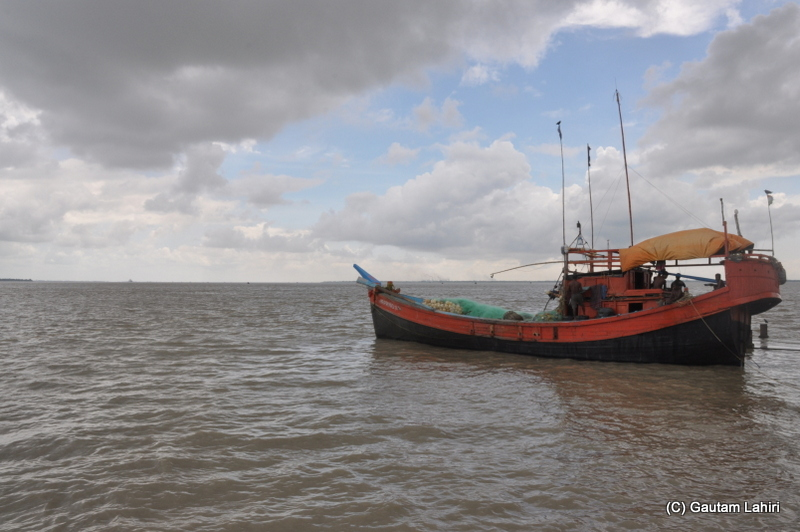 A large fishing boat sets off from the banks of river Ganges at Diamond Harbor, West Bengal, India by Gautam Lahiri