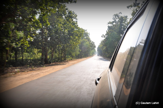 The red soil slowly settling on the car whipped up by the wheels  at Massanjore, Jharkhand, India by Gautam Lahiri