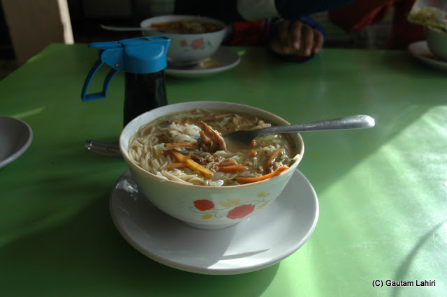Thukpa, the Tibetan dish of chicken stock, noodles with veg or non-veg mix  at Darjeeling, West Bengal, India by Gautam Lahiri