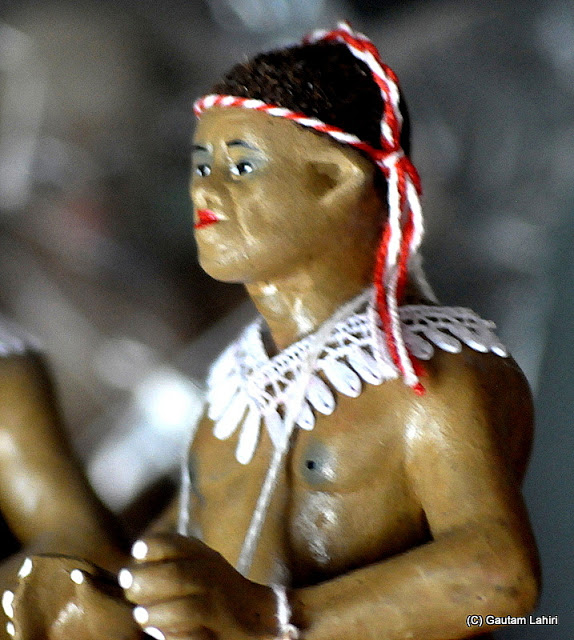 A Jarawa tribal model made of clay with their tribal embellishments and rippling muscles  at Krishnanagar, West Bengal, India by Gautam Lahiri