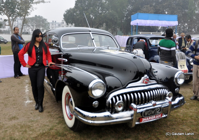 1948 Buick Super 8, the beefy American muscle car of yesteryears, stood resplendent in her black clothing  at Kolkata, West Bengal, India by Gautam Lahiri