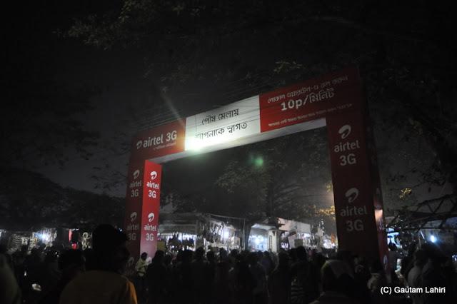Santiniketan Fair entrance stands tall among million heads, West Bengal, India by Gautam Lahiri