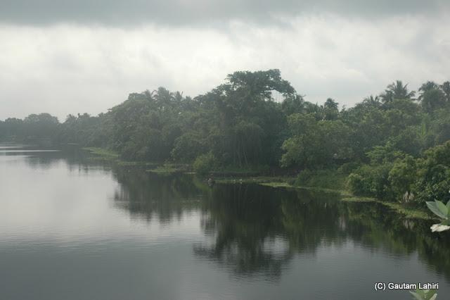 Sun and cloud played a game of light over the Jalangi river at Krishnanagar, West Bengal, India by Gautam Lahiri