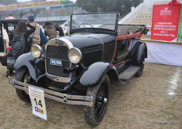 Red strip on black 1928 Ford, 12 HP, 4 cylinders parked beside the podium awaits inspection  at Kolkata, West Bengal, India by Gautam Lahiri