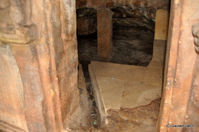 Water and air passages dug on the floor to the entrances to provide supplies to the Jain monks who stayed in these cave quarters  at Bhubaneshwar, Odissa, India by Gautam Lahiri