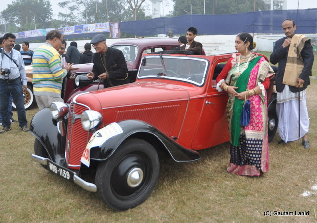 This 1938 Adler 10 HP, 4 cylinders was surrounded by her owners wearing the dress of the 1930s'. She has starred in few detective movies making her popular in Calcutta  at Kolkata, West Bengal, India by Gautam Lahiri