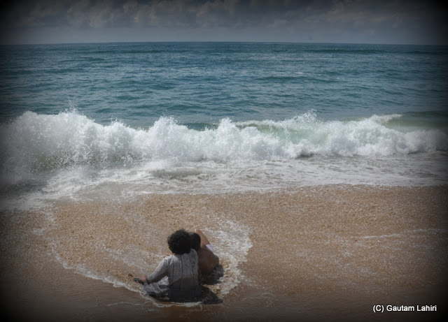 Bi-directional waves of water created a temporary wall of white sea water before breaking off to form another wave  at Puri, Bhubaneshwar, Odisha, India by Gautam Lahiri