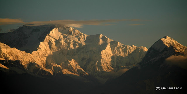 Khangchendzonga, looked like jagged-edged bullion as the first sun rays fell on the slopes  at Darjeeling, West Bengal, India by Gautam Lahiri