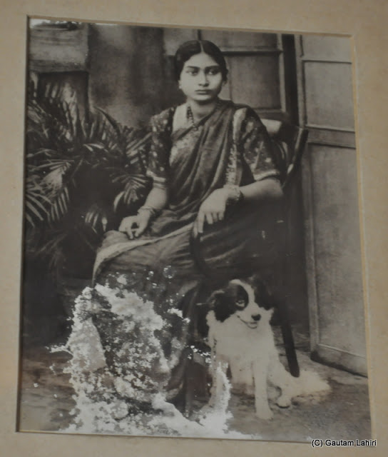 Perhaps, an inmate of this palace sitting with her pet looks at 2016 from her age at Bawali Rajbari, Kolkata, West Bengal, India by Gautam Lahiri