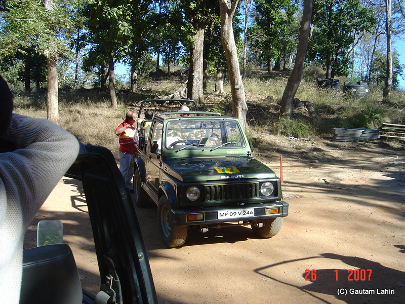 We set off with people and vehicles in search of the wild animals of Kanha forest by Gautam Lahiri