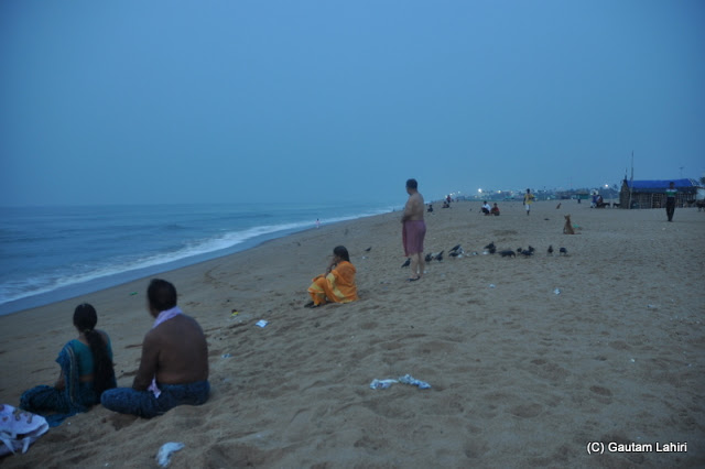 Many of us slowly joined us to view the cooler aspect of the sea  at Puri, Bhubaneshwar, Odisha, India by Gautam Lahiri