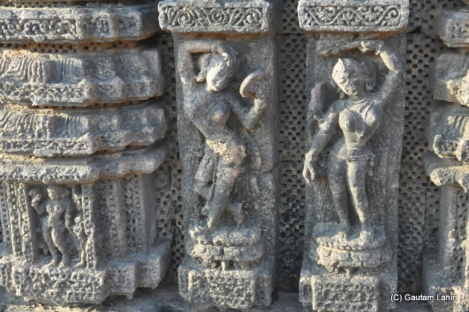 The lady on the left is looking herself in the mirror while applying vermilion on her head, which meant the know-how to make mirrors was predominant in those days  at Puri, Odisha, India by Gautam Lahiri