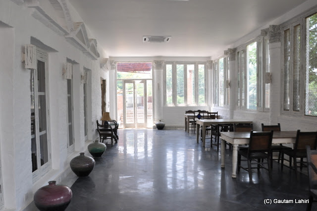The white room perhaps used for extra guests can jolly well make a visitor have an ancient meal in peace at Bawali Rajbari, Kolkata, West Bengal, India by Gautam Lahiri