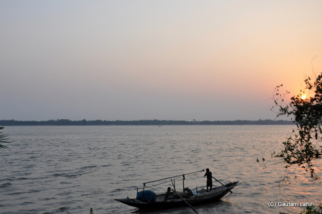 Gentle laps of the river water on the banks almost made us sleep as the boat made its way to an unknown destination at Bawali Rajbari, Kolkata, West Bengal, India by Gautam Lahiri