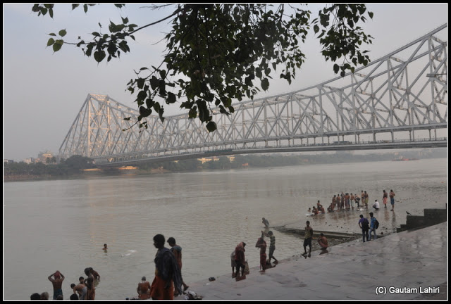 Howrah bridge flashed golden under the morning sun  at Kolkata, West Bengal, India by Gautam Lahiri