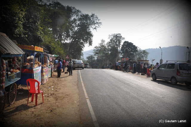 The food stalls that border the road across the dam and make your salivary gland very active  at Massanjore, Jharkhand, India by Gautam Lahiri