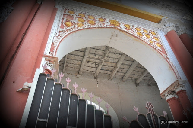 The decoration on the roof and the gate wall which had a huge metal gate with floral design on top at Krishnanagar, West Bengal, India by Gautam Lahiri